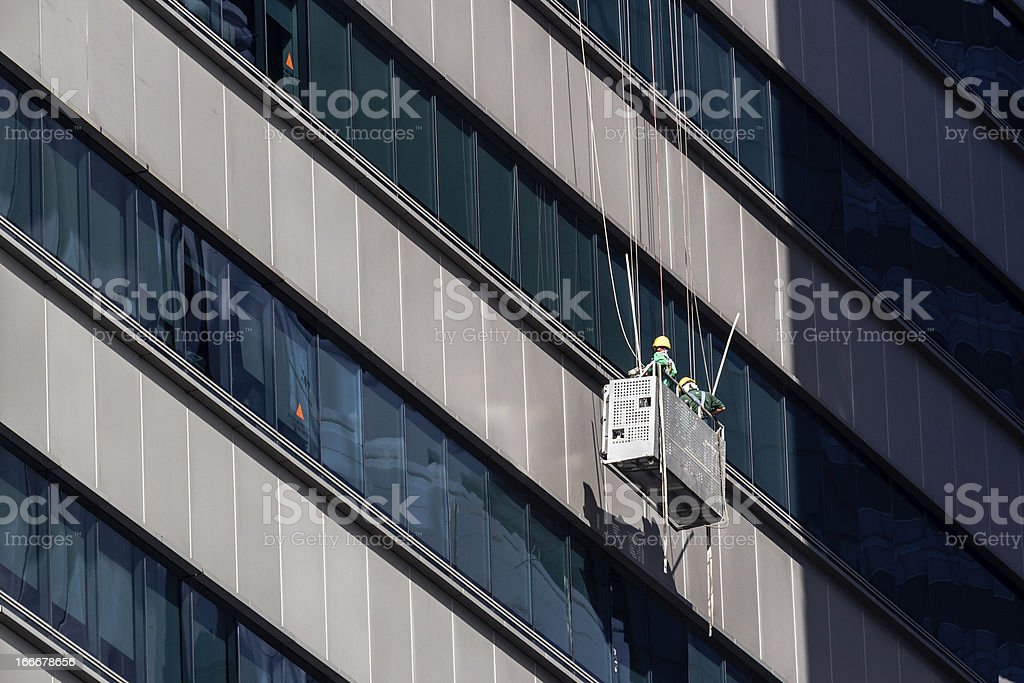 High-Rise Window Cleaners in Singapore working on Skyscraper stock photo