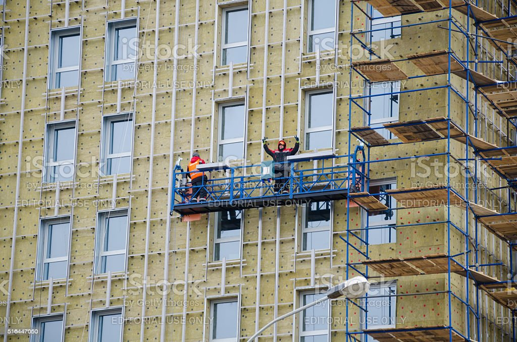 High-rise works on a facade. stock photo