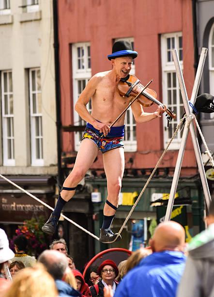Highrope walking street performer at Edinburgh Fringe. stock photo