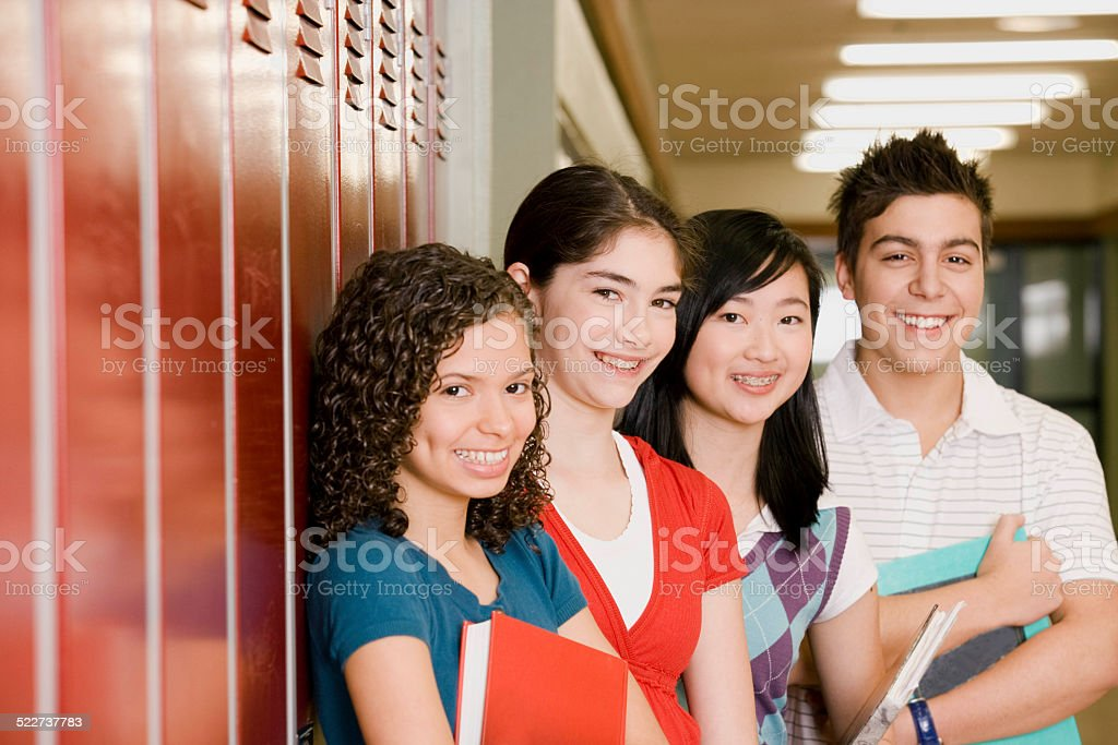 High-school students standing in front of lockers stock photo