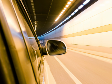824108398 istock photo High-speed car in the tunnel, Motion Blur 495303003