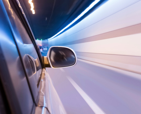 824108398 istock photo High-speed car in the tunnel, Motion Blur 495303005