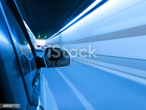 istock High-speed car in the tunnel, Motion Blur 495337127