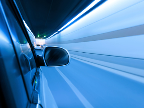 824108398 istock photo High-speed car in the tunnel, Motion Blur 495337127