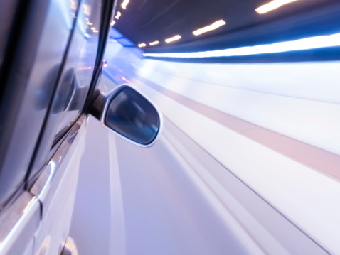 824108398 istock photo High-speed car in the tunnel, Motion Blur 495337129