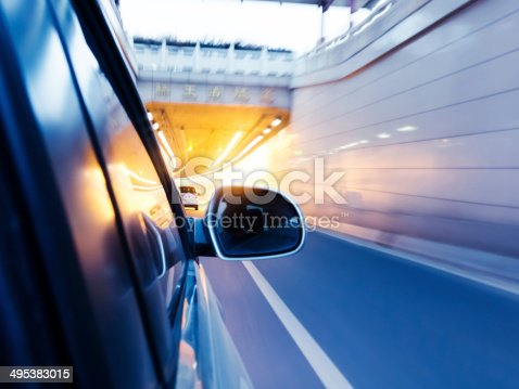 istock High-speed car in the tunnel, Motion Blur 495383015