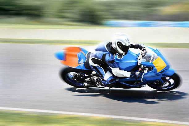 highspeed motorbike racer on closed track - motorsport stock photos and pictures