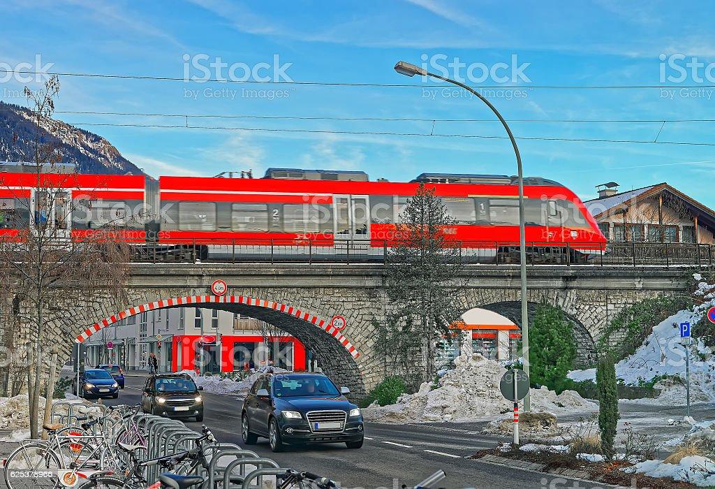 High-speed train crossing a bridge in Garmisch-Partenkirchen stock photo