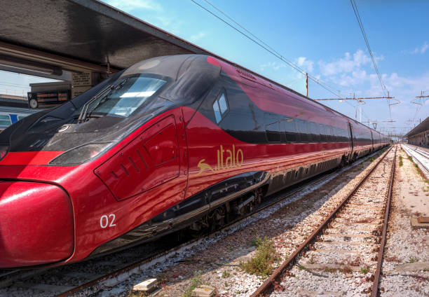 high-speed train italo at the station of venice. close-up. the train cars italo are very comfortable. high-speed train of red color at the platform - milan railway foto e immagini stock