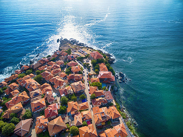 Hight angle view of Sozopol, Bulgaria High angle view of  Sozopol, Bulgaria. Houses and vehicles, old ruins on rocks. bulgaria stock pictures, royalty-free photos & images