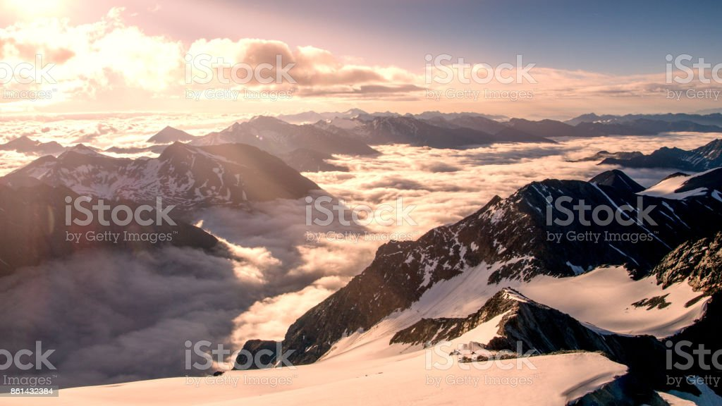 Hight mountain peaks and white clouds. stock photo