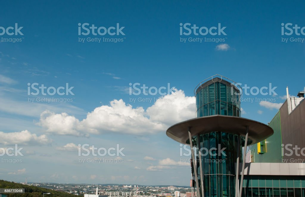 High-tech building on the background blue sky and clouds, stock photo