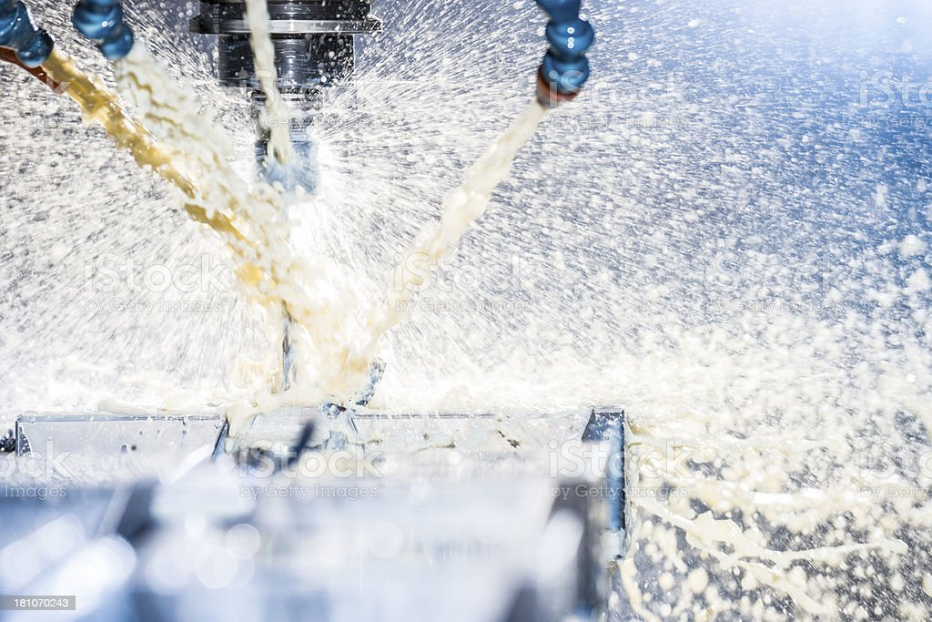 High-tech, industrial metal milling machine in action stock photo