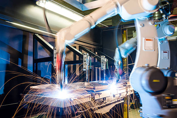 high-tech, industrial robotic welding machines - robotics manufacturing stock photos and pictures