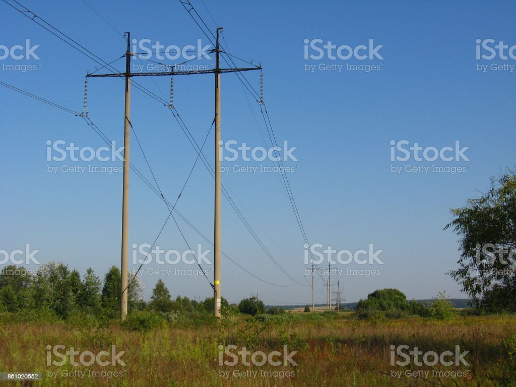 high-voltage line in the field stock photo