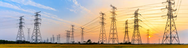 high-voltage power lines at sunset high-voltage power lines at sunset,high voltage electric transmission tower power line stock pictures, royalty-free photos & images