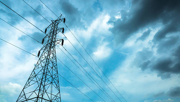 High-voltage sky background. Electrical poles of high voltage in white cloud and blue sky / electric pole power lines and wires with blue sky / high voltage equipment on an electric pole / High-voltage sky background. telephone line stock pictures, royalty-free photos & images