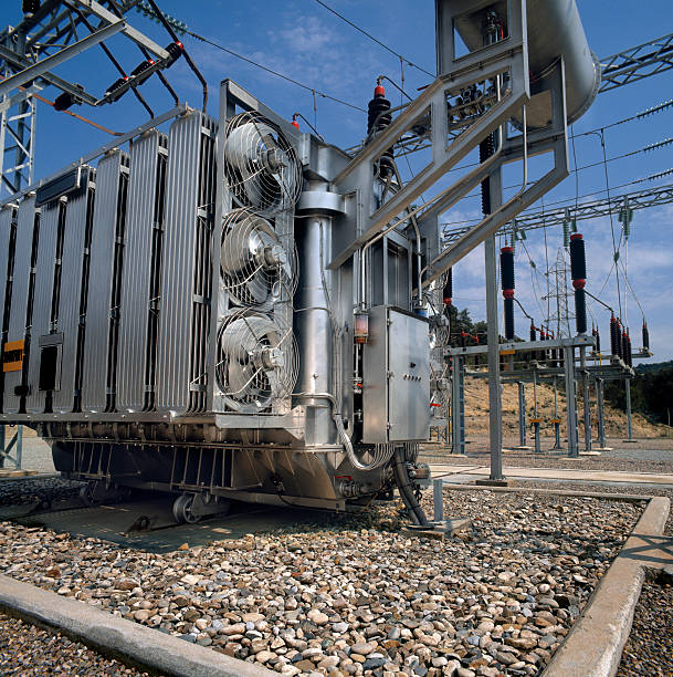 High-voltage supply transformer High-voltage supplay transformer. Medium format film photography shot electricity transformer stock pictures, royalty-free photos & images