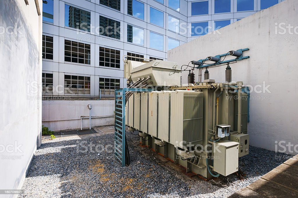 High-voltage transformer in highrise building royalty-free stock photo