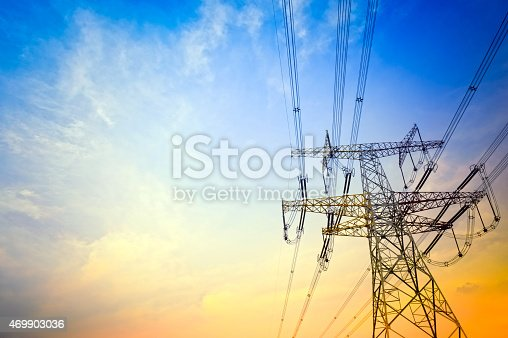 High-voltage wire tower at dusk