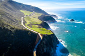 Highway 1 California USA Raod on Ocean, Hills and fields are surrounding the picture