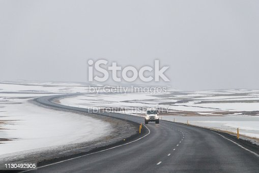 657042754 istock photo Highway 1 Iceland. Winding road covered with snow in winter.ring road, route 1 in Iceland 1130492905