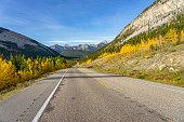 Highway 66 runs through autumn landscape of Kananaskis region in Alberta, Canada.