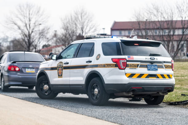 Highway 83 north sign in Pennsylvania with car stopped by police state trooper Harrisburg, USA - April 6, 2018: Highway 83 north sign in Pennsylvania with car stopped by police state trooper trooper stock pictures, royalty-free photos & images