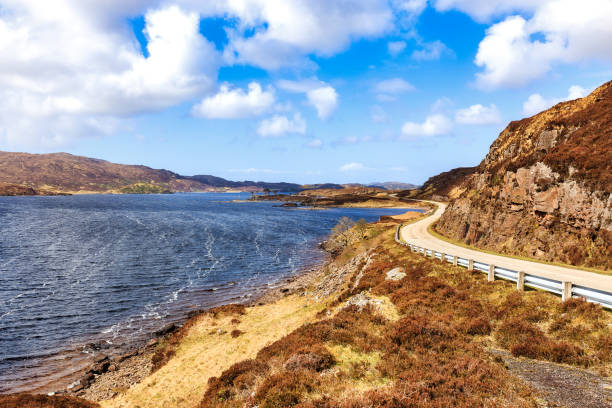Highway A837 along Loch Assynt in the scottish highlands Highway A837 along Loch Assynt in the scottish highlands near Ardvreck Castle north coast 500 stock pictures, royalty-free photos & images