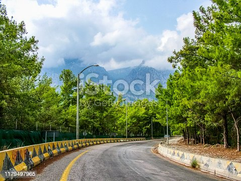 Highway among the Taurus Mountains in the region of Kemer and Beldibi in the province of Antalya. Turkey. Coniferous trees surround the path.