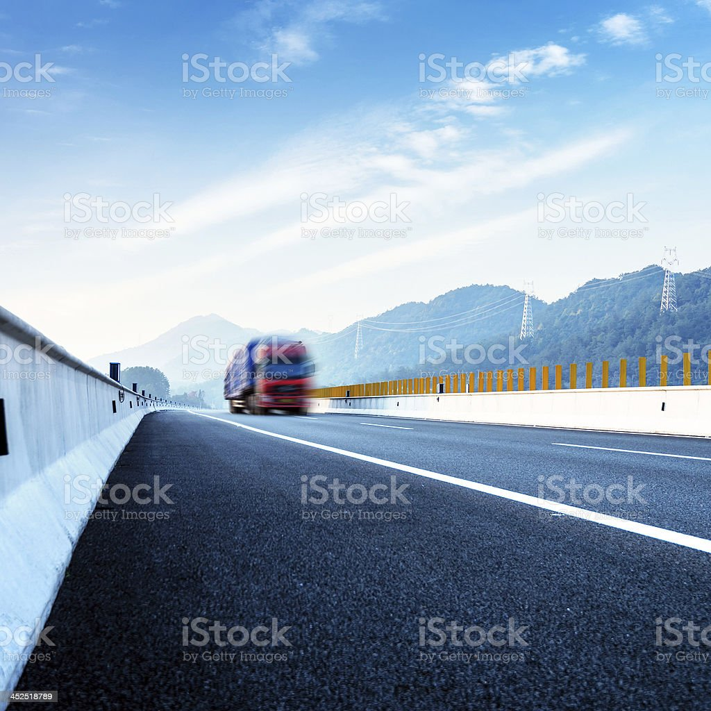 Highway and red truck stock photo