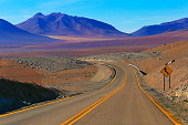Highway asphalt Road to Atacama Desert  – dramatic volcanic landscape –  Chile