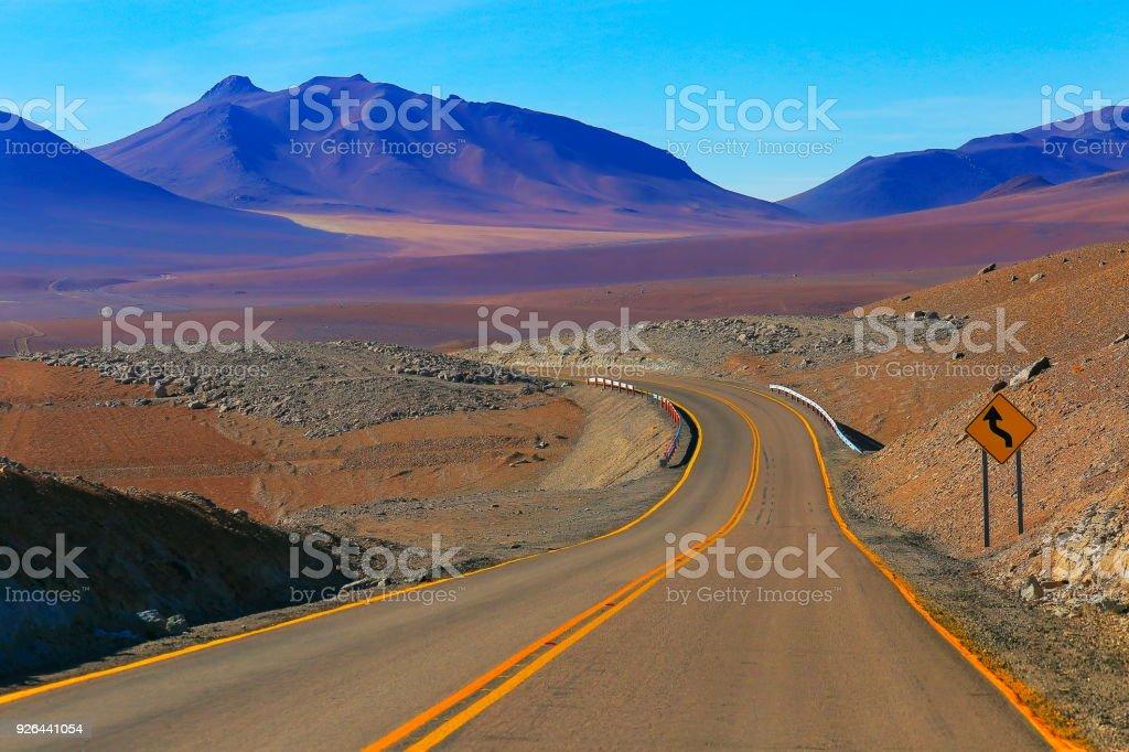 Highway asphalt Road to Atacama Desert  – dramatic volcanic landscape –  Chile stock photo