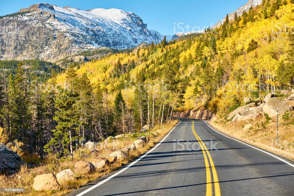 Highway at autumn in Colorado, USA. stock photo