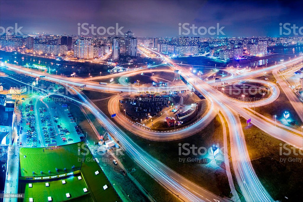 Highway at night in modern city. Aerial view of cityscape stock photo