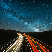 Highway lights under the milky way