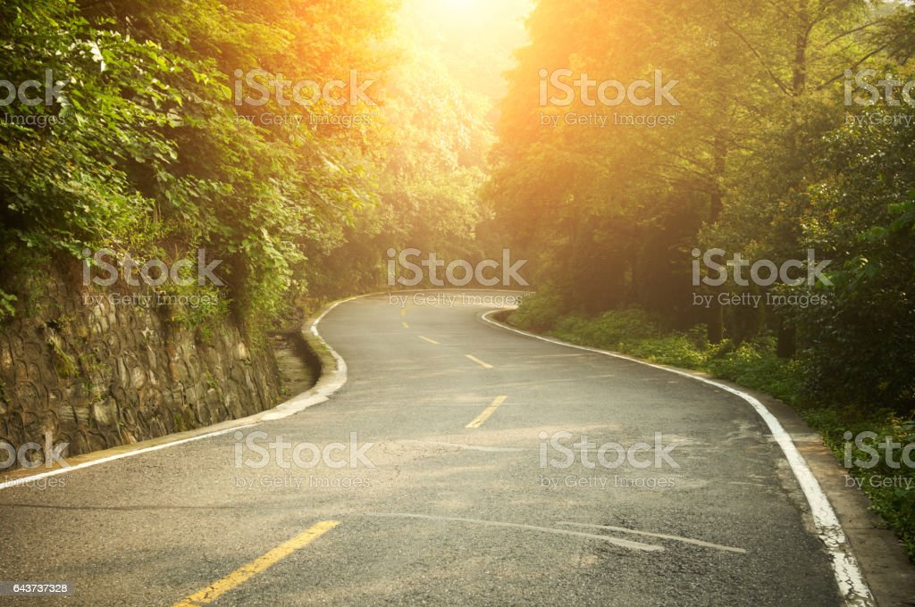 highway at sunrise stock photo