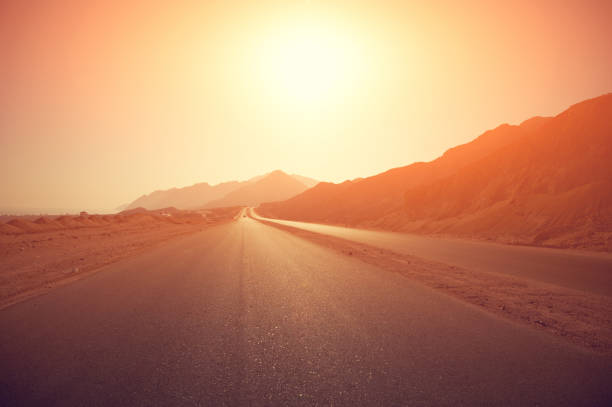 highway at sunrise stock photo