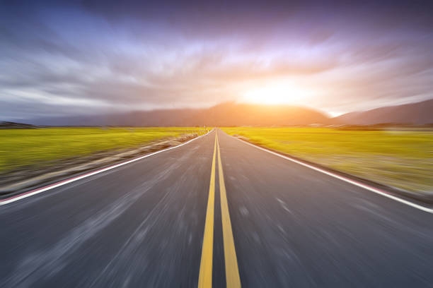 highway at sunset - straight stock photos and pictures