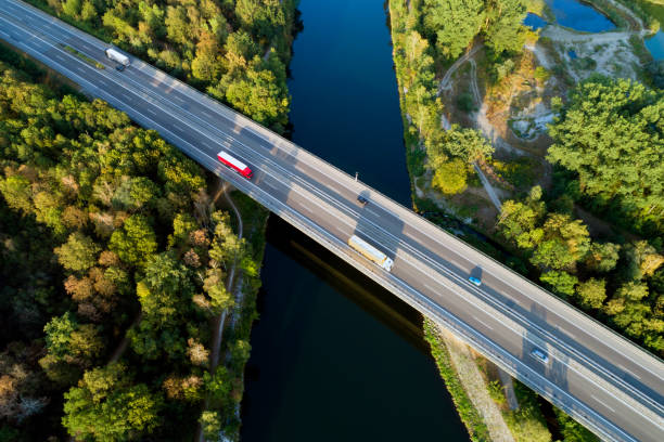 Highway Bridge, Aerial View Aerial view of highway bridge over Danube River, Bavaria, Germany overpass road stock pictures, royalty-free photos & images