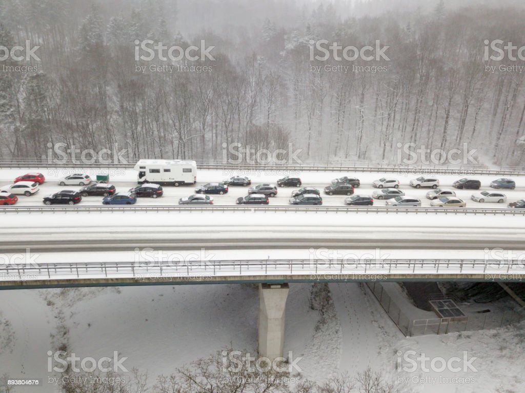 Highway bridge during a heavy snowfall stock photo