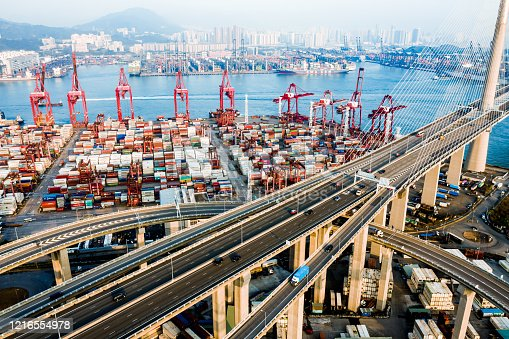 istock Highway Bridge in Hong Kong and Container Cargo freight ship 1216554978