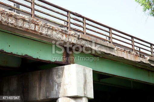 The concrete of this highway bridge has deteriorated over the years.  The bridge is located on Interstate 490 in Pittsford, NY, USA.