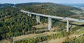 Highway bridge through forestland - aerial view