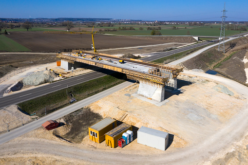 Construction of a highway bridge over the road, aerial view.