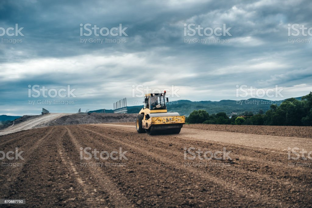 Highway construction site details - working tandem vibration machinery stock photo