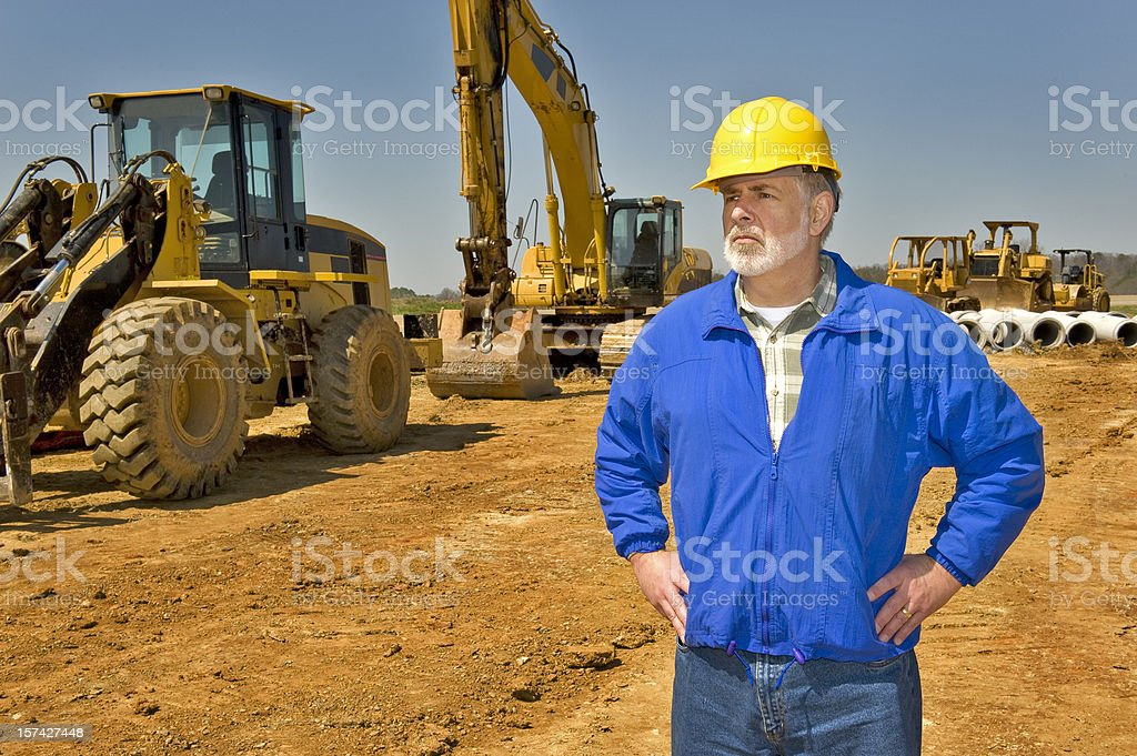 Highway Construction Worker and Equipment royalty-free stock photo