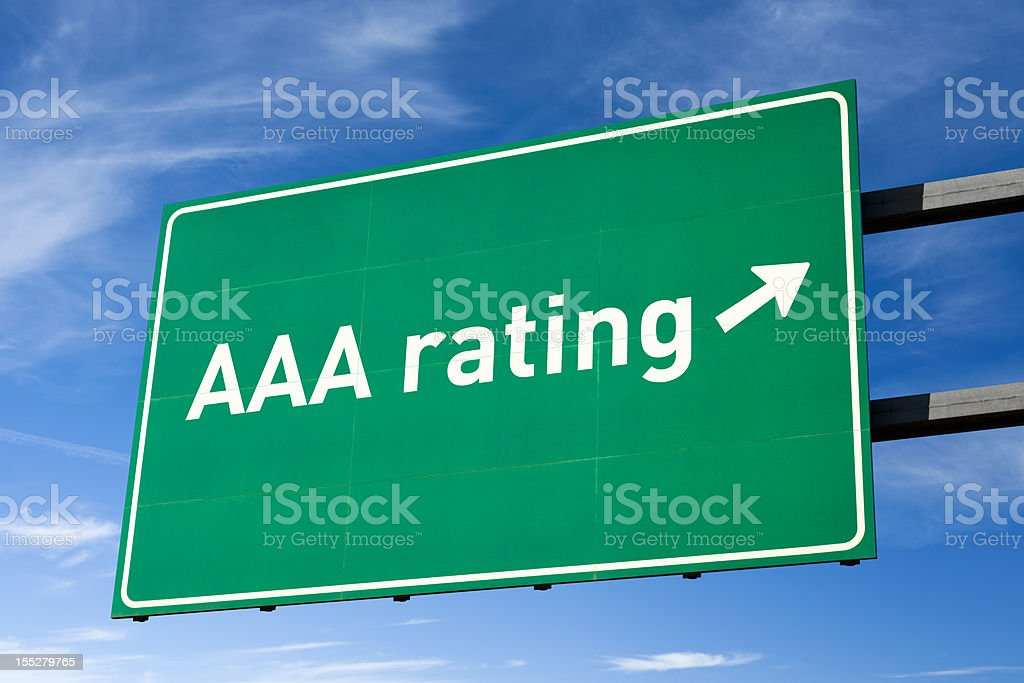 Highway directional sign for AAA credit rating, clipping path royalty-free stock photo