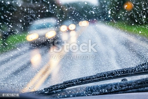 1054750504 istock photo Highway Driver POV Through Raindrop Car Windshield During Rain Storm 613216216