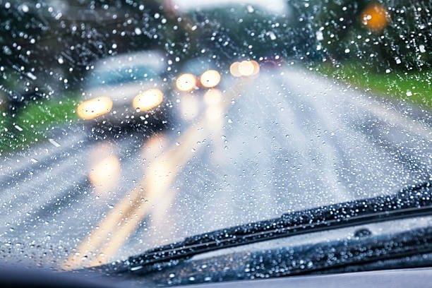 Highway Driver POV Through Raindrop Car Windshield During Rain Storm stock photo